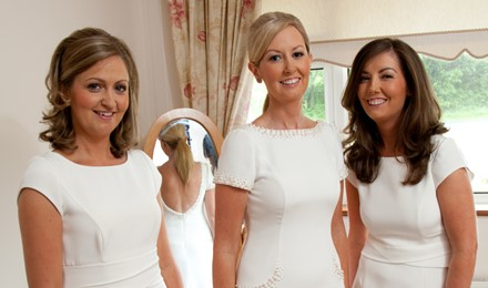 Bride and Bridesmaids all white dresses on wedding morning, blond and brunette makeup and hair applied. co sligo