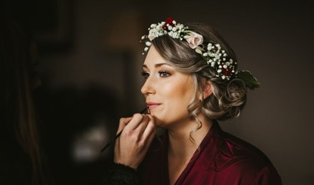 Kate having her lipstick touched up , Bridesmaid makeup, flower crown , brown natural eyemakeup , mount falcon co mayo.